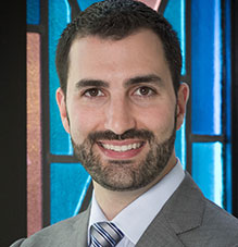 Headshot of Cantor Marcus Feldman